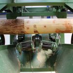 Wooden pole peeling machine